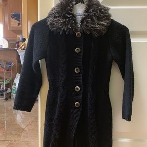 A black coat with buttons